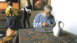 Tim Jenison shown in his perfect reproduction of Vermeer's workroom with the optical device he invented and built to exactly replicate what he believes is Vermeer's artistic method.