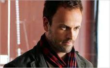 Jonny Lee Miller as a present-day Sherlock Holmes in CBS's Elementary.