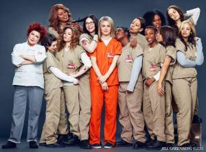 Piper Chapman (in orange) as the new inmate on the block in Netflix's Orange Is the New Black.