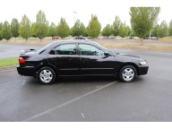 A 1999 black Honda Accord