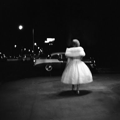 A stunning photo of a woman dressed for the evening. And what a car! Vivian Maier/John Maloof