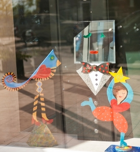 Gracing the window of the Emporium Building is artwork called Diverse Sculptures nu Jim Parris and Gwendolyn Kerney (girlBGlad.com).