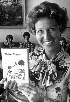Evangelical Christian writer Maribel Morgan holding her bestselling book (circa mid 1970's). Get a load of that hair.