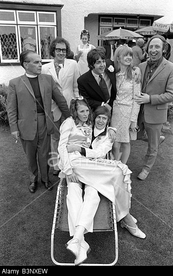 British musician and poet Roger McGough (second from left) standing beside Beatle Paul McCartney in this 1968 wedding photo.