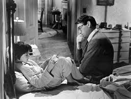 Mary Badham as Scout and Gregory Peck as Atticus in the movie version of To Kill a Mockingbird.