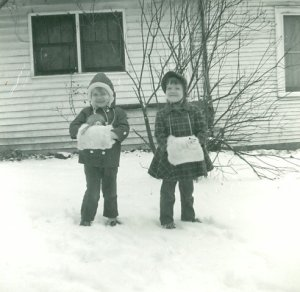 My sister Lisa and me in the snow outside our home, 1963