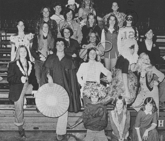 The 1975 high school drama club with Tom Parkhill standing (front row 2nd from left) with what looks like a humongous fan.