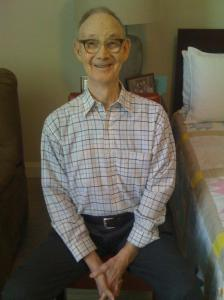 Daddy sitting beside his bed at his senior living facility a few weeks before his hospitalization.