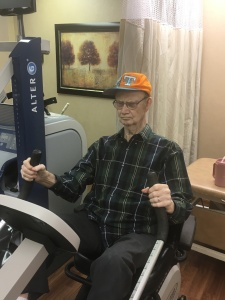 Daddy on the exercise bike at his rehab center, a few days before he died.